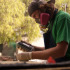 """City college art student, Ben Eckert, uses his new green spray paint to paint his sculpture on Wednesday, Oct. 15, in Santa Barbara, Calif. Eckert said, """"I just recently got this spray paint and I really like the shade."""" His favorite color is green."""