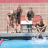 "City College swimmer, Sarah Westmorelan, swims as anchor in the 4x100 yard freestyle relay while teammates (from left), Elise Hazel, Madelyn Brooks, Autumn Lovett and Katherine ""Moose"" Warren cheer for her on Saturday, March 28, 2015, at San Marcos High School in Goleta, Calif. City College placed first in this race with a final time of 4:02.69."