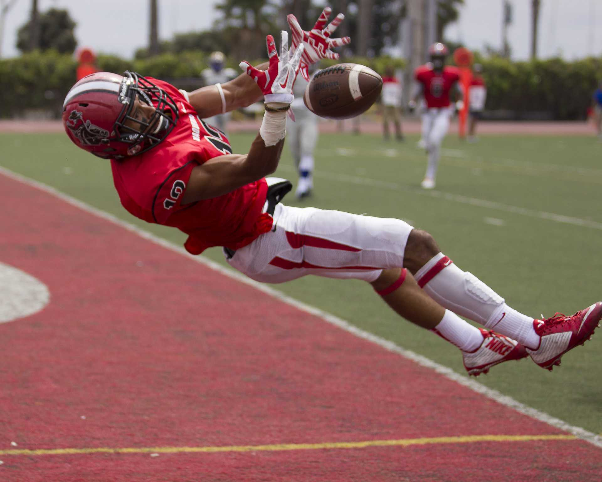 Receiver Elijah Cunningham (No. 13) of City College attempts to make a catch in the end zone Saturday afternoon Sept. 12 at La Playa Stadium. City College beat Hancock, 21-20.