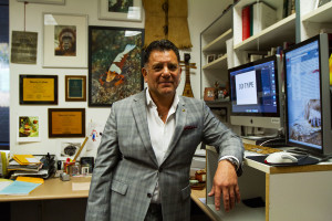 Michael Gallegos, associate professor in the multimedia arts and technology department, is an avid diver and underwater photographer, Tuesday, Nov. 10, in his office on East Campus at City College. Gallegos has traveled the world taking photographs, some of which hang in his office.