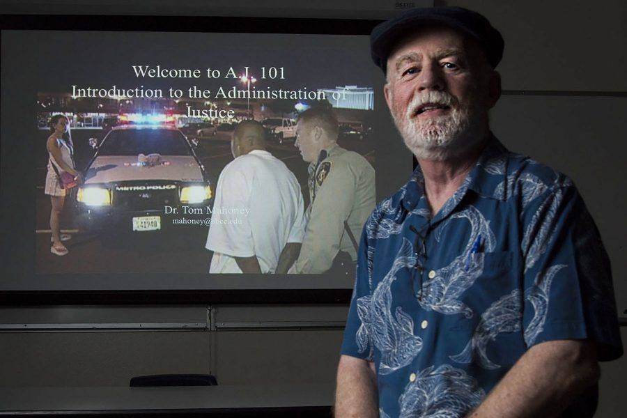 Dr. Tom Mahoney, School of Justice Studies professor, demonstrates his administration of justice lecture on Wednesday, Nov. 9, in his classroom at City College. Mahoney will be retiring at the end of the spring semester after 18 years at City College.