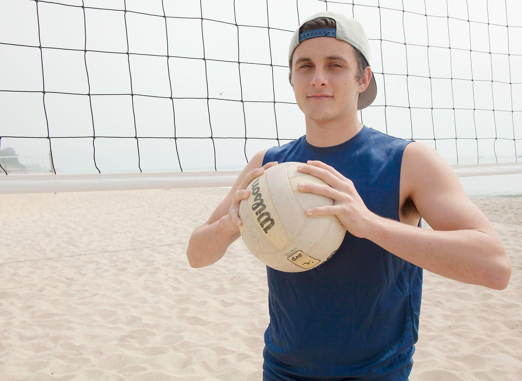 Volleyball Player Libero Kealakahi Spain on Friday, March 17,  in front of the volleyball nets at East Beach. Spain is a freshman from Hawaii and is leading the men's volleyball team in Digs and has a 2.06 dig per set ratio.
