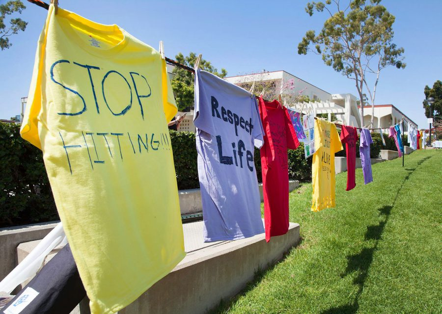 Different+colored+shirts+that+students+have+written+on+for+the+Clothesline+Project+on+April+12%2C+at+the+Friendship+Plaza+at+City+College.+At+the+event%2C+students+made+different+colored+shirts+to+tell+their+story.+A+red+shirt+symbolizes+rape%2C+a+yellow+shirt+symbolizes+domestic+violence%2C+and+a+purple+shirt+stands+for+physical+or+sexual+abuse+against+the+LGBT%2B+community.