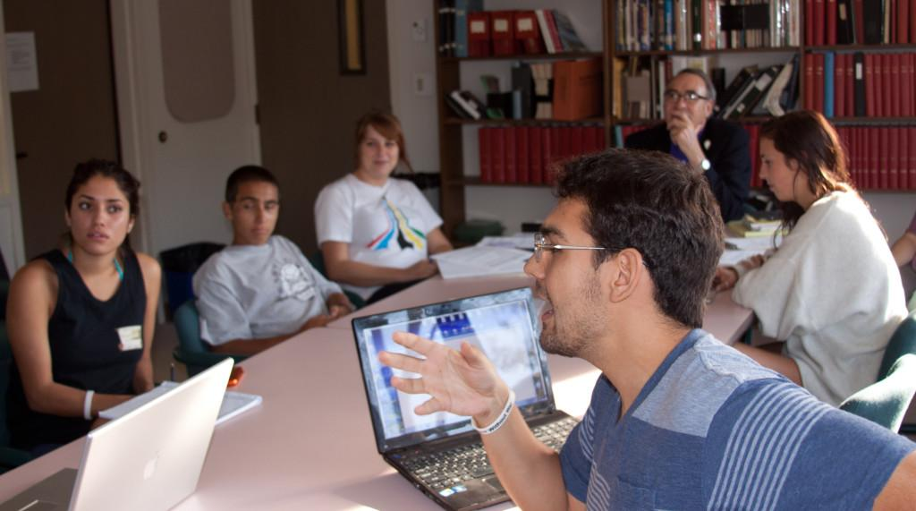 Joshua Wheeler (front) leads a discussion with the staff from A Year Without War on Oct. 9 in the Luria Library.