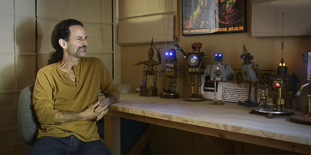 Video: Math teacher melds scraps into robot art