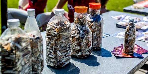 Student volunteers clean up cigarettes around campus