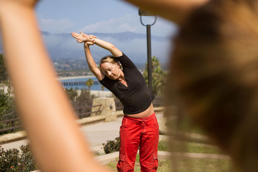 Betsy Phillips shows students how to perform a half moon pose during her free yoga session hosted on the Winslow Maxwell Overlook at City College on Monday, Sept. 9, 2013 in Santa Barbara, Calif.