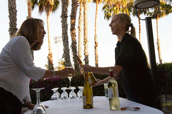 Lacie Smith serves wine to Judy Edner at the Food for Thought Dinner, in the John Dunn Gourmet Dining Room, on Sept. 16, 2013. This event raises money for the culinary students from the Julia Childs endowment.