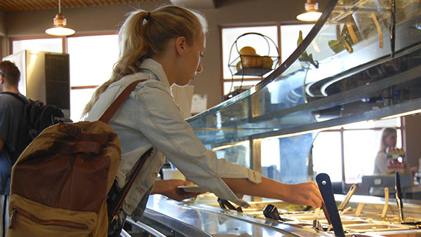 Jennifer Bowman, 20, communications student, browses through her options at the new salad bar in the Snack Bar cafeteria at City College on Wednesday, Sept. 11, 2013 in Santa Barbara, Calif.