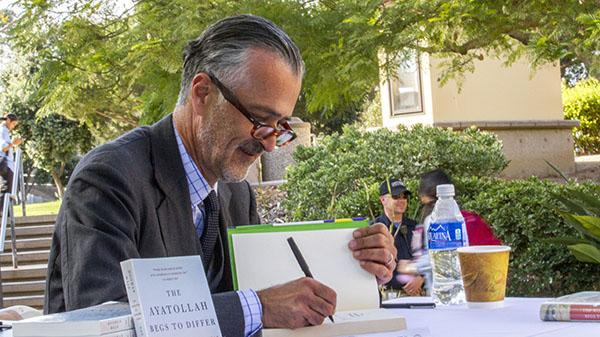 Hooman Majd signing books in an Administration Building courtyard on Santa Barbara City College's East Campus in Santa Barbara, California on October 10, 2013 between 4:00pm and 5:00pm.