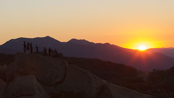 Members of the Excursion Club wake up to see the sunrise after a night of camping at Lizard's Mouth early Saturday morning, Oct. 19, 2013 in the Santa Ynez mountains.
