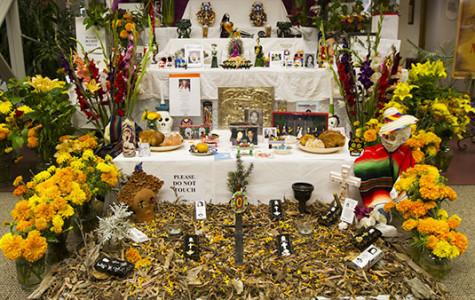 A display representing the unity of life and death for this year's annual Dia de Los Muertos art exhibit at City College Luria Library on Oct. 30, 2013, in Santa Barbara, Calif.