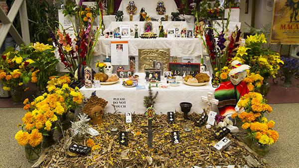 A display representing the unity of life and death for this years annual Dia de Los Muertos art exhibit at City College Luria Library on Oct. 30, 2013, in Santa Barbara, Calif.