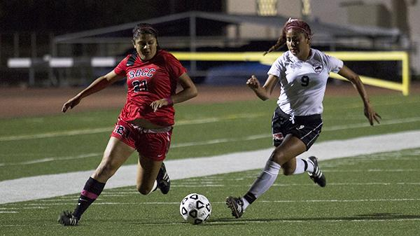 Briana Lopez (No.21) for Santa Barbara City College fights for the ball against Jessica Castillejo (No.9) LA Pierce College. On Oct, 4, 2013 at La Playa Stadium.