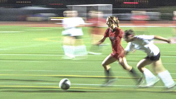 In Santa Barbara, Calif. At Del Playa Stadium, Forward Brandie Harris shows off her unstoppable quickness against Cuesta, ending in another goal.