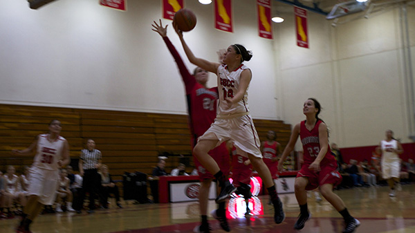 Jasmine Mata (No14) shoots against Andrea Harris (No21) during the basketball game against Bakersfield College at the City College Sports Pavilion in Santa Barbara, Calif. on Tuesday, Nov. 19, 2013.