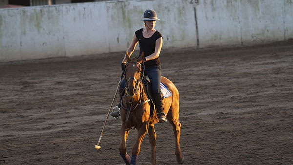 Lauren Kelbe, City College student, practices polo at the Santa Barbara Polo School in Carpinteria, Calif. on Nov. 14, 2013.