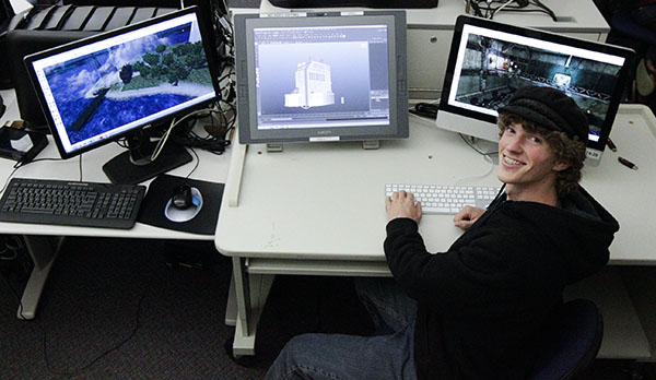 Andrew Price, 19, video game and animations major, designs in the Digital Arts Lab at City College on Thursday, Oct. 31, 2013, in Santa Barbara, (Calif.) He is working on an environmental buildings project in the program Maya.
