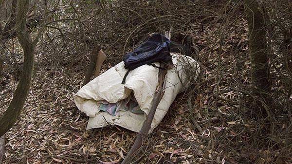 A stashed blanket and backpack at the wooded area on West Campus of City College on Thursday, Nov. 14, 2013, in Santa Barbara, Calif.