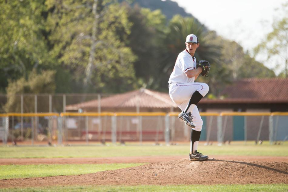 Tyler Gilbert (No.12) goes into his windup at the Vaqueros' home game against East Los Angeles College on Thursday, Feb. 20, at Pershing Park in Santa Barbara, Calif.  City College went on to win the game 11-6.