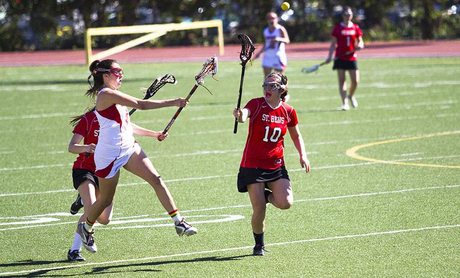 City College lacrosse player Megan McCullough (No. 8) races to catch the ball against College of St. Benedict on Friday, Feb. 14, 2014, at La Playa Stadium in Santa Barbara, Calif.  The Vaqueros lost 10-8.