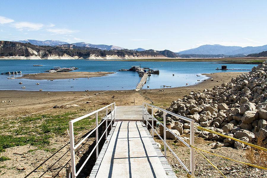 Water levels at Lake Cachuma, Calif. are at historic lows on Feb. 5. The boat marina has had to lower the floating docks past the stair level and lake visitors have to walk through a section of shoreline before reaching the dock.
