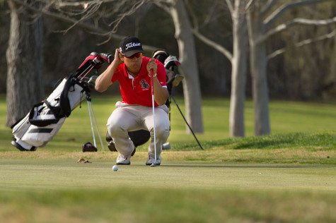 On Monday, February 17, 2014 Santa Barbara City College Golf Team member Jackie Chan, eyes up a putt for birdie on the 2nd hole of the Alisal Ranch Golf Course. The Course and Santa Barbara City College played host to the Western State Conference number 2 tournament.