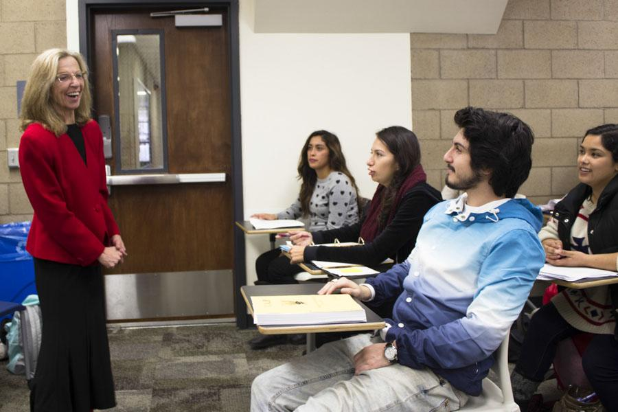 English Professor Jody Millward laughs with her students before class in her classroom at the Interdisciplinary Center at Santa Barbara (Calif.) City College on Feb. 28, 2014. Millward is one of four two-year-college professors who won the prestigious Hayward Award.