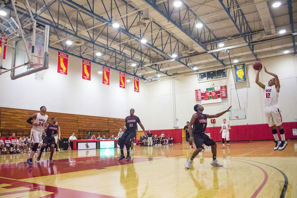 City College's sophomore guard, Pablo Miranda (No. 12), attempts a three-point shot against Los Angeles Pierce College on Saturday, Feb. 22, in Santa Barbara. Miranda finished the game with 10 points as the Vaqueros lost to the Brahmas 96-87.