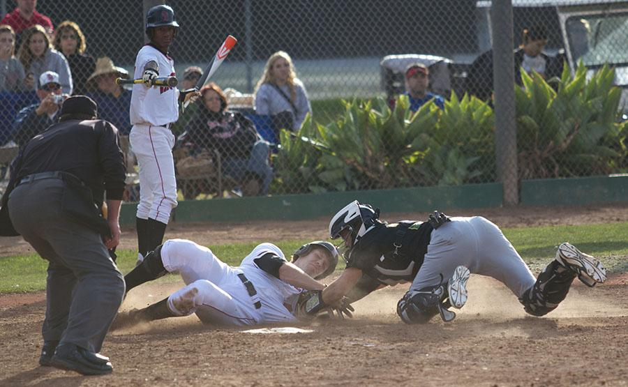 Trey Barrett (No.44) slides in safely at home plate during City College Vaqueros baseball home opener against Napa Valley College on Friday, Jan. 31, at Pershing Park in Santa Barbara. The Vaqueros won the first game of the three-game opening series 9-3.
