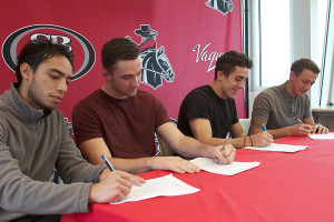 Men's soccer players Juan Diaz Casallas (left), George Wakefield, Jamie Sporcic and Adam Colton commit to play at the University of Hawaii at Hilo on Thursday, Feb. 6, in Santa Barbara.