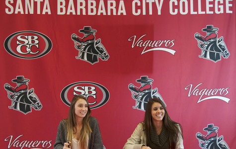 Soccer players Brandie Harris, left, and Heather Rivera sign their letters of intent to California State University, San Bernardino, on Thursday, Feb. 6, 2014, in Santa Barbara, Calif.