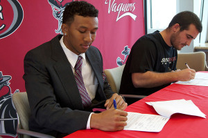 Tavonte Jackson (left) signs his letter of intent to Idaho State University and Jackson Weed signs with Glenville State College at a press conference on Thursday, Feb. 6, in Santa Barbara.