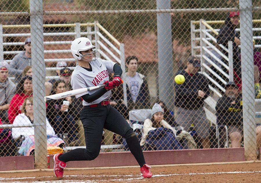 Brianna Portese (No. 7) knocks a base hit to left field during the second game of the Vaqueros softball home opener against Pasadena City College on Saturday, Feb. 8, at Pershing Park in Santa Barbara.