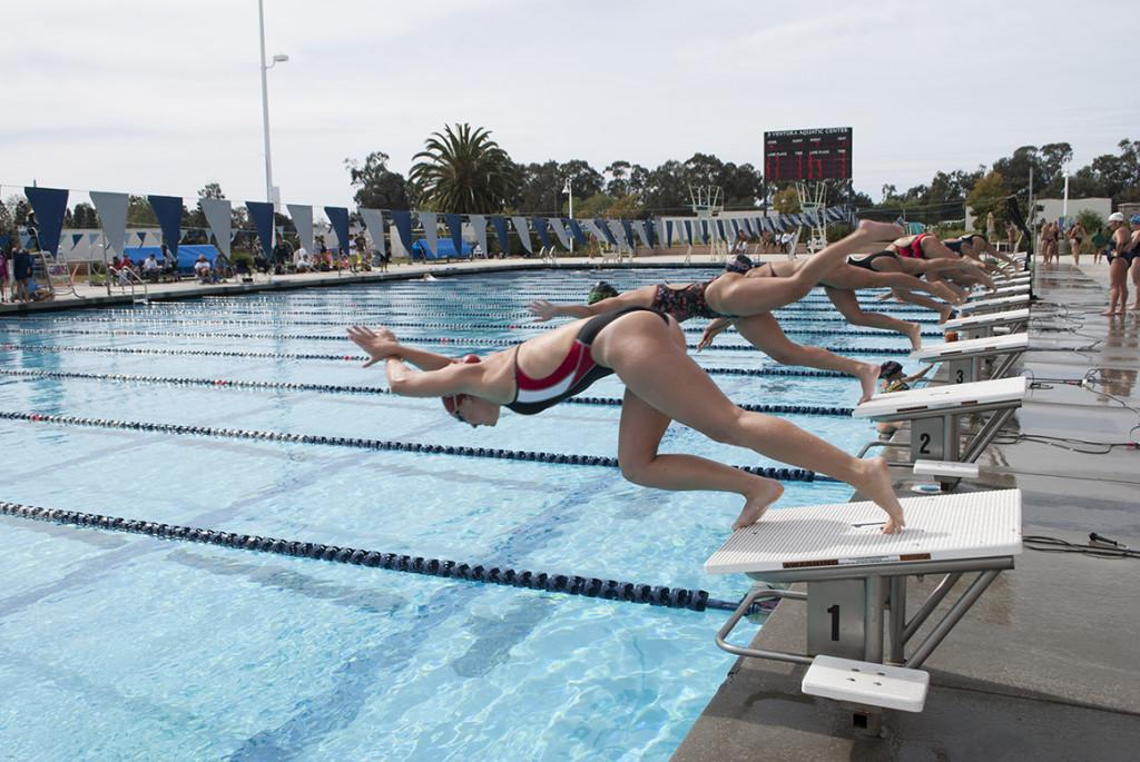 City College's Emily Foster (closest) competes in the women's 100-yard freestyle during the Western State Conference Pentathlon on Feb. 15, 2014, at the Ventura Aquatic Center in Ventura, Calif.