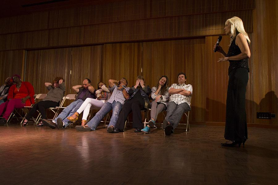 Volunteers from the audience have been put to sleep by hypnotist, Nancy Segal (right), inside the City College Fé Bland Forum, Friday Feb. 21. Segal is a hypnotist and spiritual healer who began her practice after using hypnotism to self-heal her body from mercury poisoning.