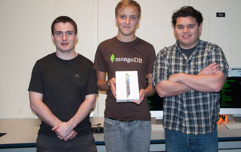 Three City College students,  (from left) Joel Green, Erwan Lent and Alberto Villalobos,  display their prize, an iPad mini, after winning the Hacktech hackathon.