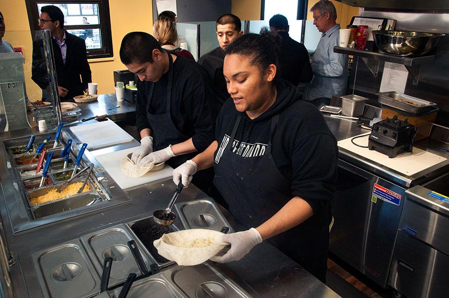 Leandra Harris, City College student worker, makes a custom burrito at the Burrito Shack on East Campus. The Shack is open from 10 a.m. to 4 p.m., Monday to Friday.
