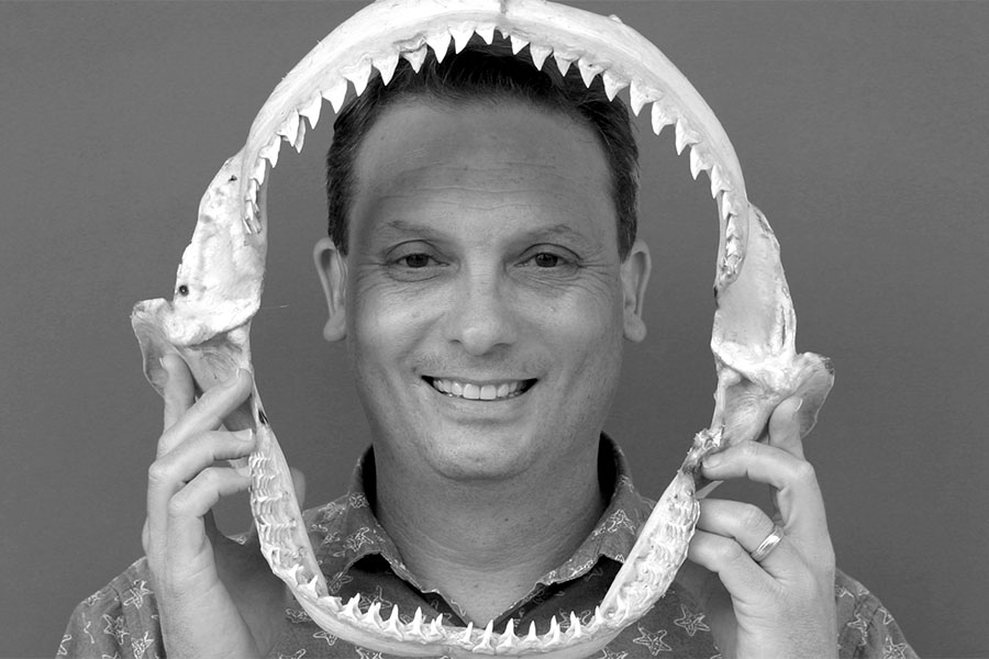 Blake Barron holds the jaws of a shark.