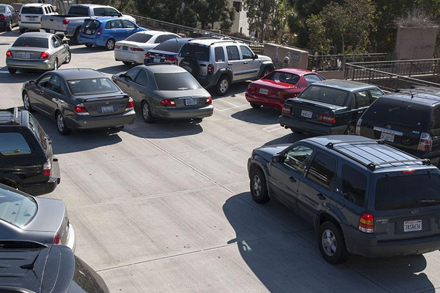 A traffic block is formed by cars waiting for open parking spots on Tuesday, Feb. 25, at parking lot 5-3 on West Campus, in Santa Barbara. Drivers have to wait several minutes for spots to open up because of the lack of parking at City College Campus.