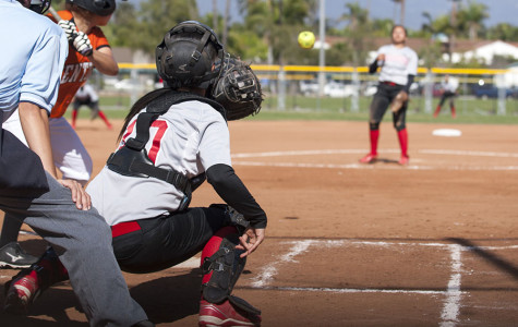 Vaqueros' catcher Dakotah Wilcox (No. 10) reaches for the ball thrown by pitcher Celeste Acosta as Ventura's Emily Heath gets ready to swing Thursday, March 20, at Pershing Park in Santa Barbara. The Vaqueros won the game against Ventura, 4-3.
