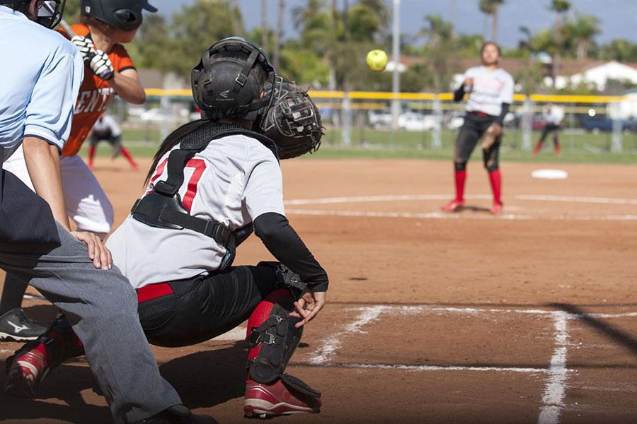 Vaqueros%E2%80%99+catcher+Dakotah+Wilcox+%28No.+10%29+reaches+for+the+ball+thrown+by+pitcher+Celeste+Acosta+as+Ventura%E2%80%99s+Emily+Heath+gets+ready+to+swing+Thursday%2C+March+20%2C+at+Pershing+Park+in+Santa+Barbara.+The+Vaqueros+won+the+game+against+Ventura%2C+4-3.