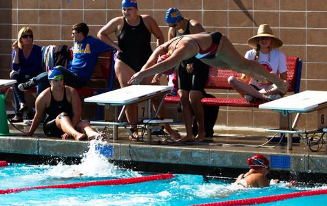 City College swim team member Sarah Westmoreland leaps from the starting block after teammate Janina Schulz completes her leg of the women's 400 yard freestyle event on Friday, March 28, at San Marcos High School in Santa Barbara. The relay team took third place with a time of 4:06.71, despite some confusion with their starting gate, because of the fact that the lead off swimmer Emily Foster had just exited the pool after finishing her 100 yard breaststroke event.