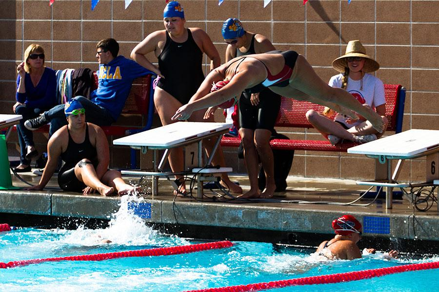 City+College+swim+team+member+Sarah+Westmoreland+leaps+from+the+starting+block+after+teammate+Janina+Schulz+completes+her+leg+of+the+women%E2%80%99s+400+yard+freestyle+event+on+Friday%2C+March+28%2C+at+San+Marcos+High+School+in+Santa+Barbara.+The+relay+team+took+third+place+with+a+time+of+4%3A06.71%2C+despite+some+confusion+with+their+starting+gate%2C+because+of+the+fact+that+the+lead+off+swimmer+Emily+Foster+had+just+exited+the+pool+after+finishing+her+100+yard+breaststroke+event.
