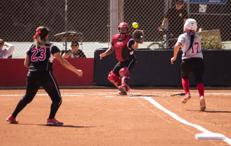 City College freshman infielder, Christal Vierra (No. 17), heads home after Brianna Portese's base hit as Vikings catcher Jenny Santiago prepares for the throw from Melyssa Rivas (No. 23). Vierra scored but it wasn't enough as the Vaqueros lost, 17-6.