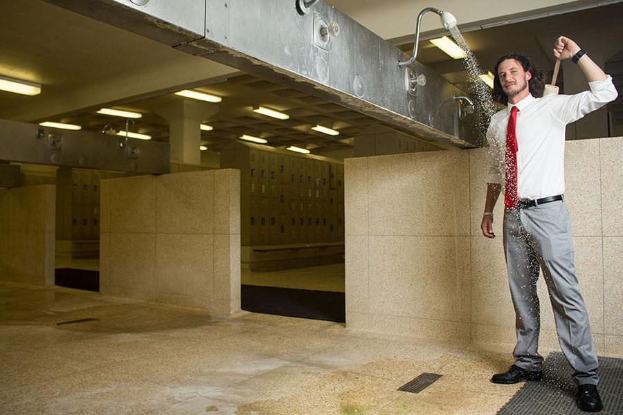 Nicholas Steil, vice president of Student Affairs, visits the men's locker room on Friday, Feb. 28, in the Sports Pavilion at City College. Steil, 35, has been pushing for the initiative to allow homeless students access to locker room showers for over a year.