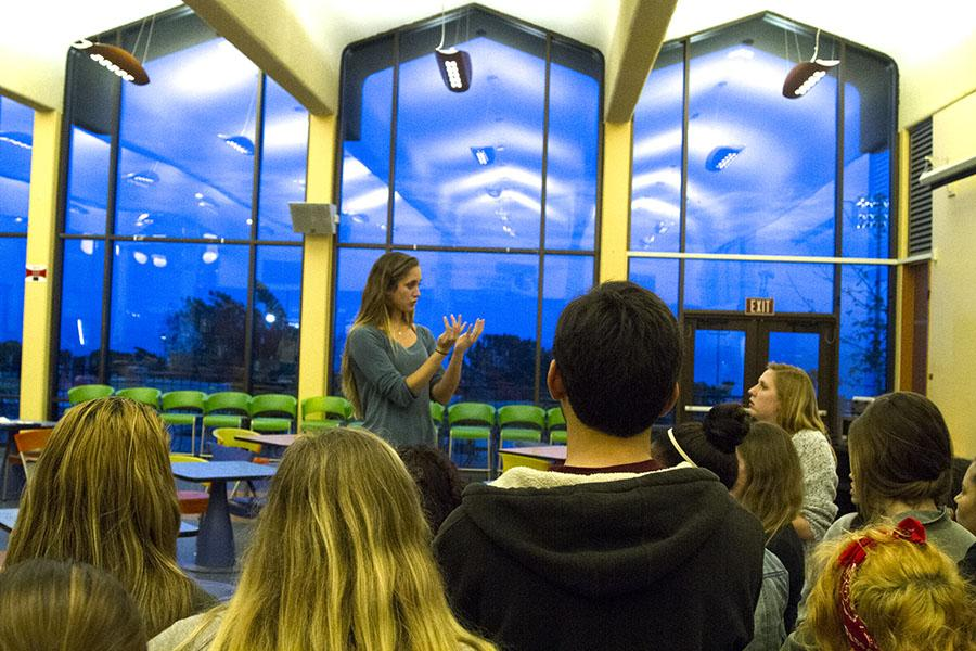 City College students attend an American Sign Language Club meeting, where President Jessica Clark, 20, explains the rules for a game in vocal silence, on Wednesday, March 5, in the Main Cafeteria at City College. Signing is a visual language in which the brain processes linguistic information through the eyes.