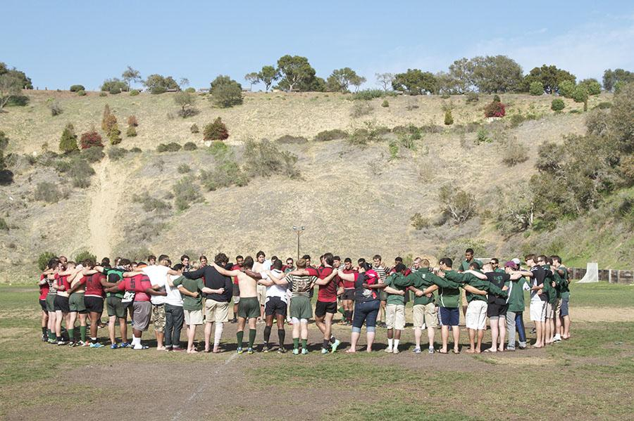 Santa Barbara Rugby Academy and Dartmouth College rugby teams join together after their match on Thursday, March 20, at Elings Park in Santa Barbara. Santa Barbara defeated Dartmouth, 48-22.