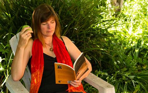 Santa Barbara's newest Poet Laureate, and former City College student (2003-2005), Chryss Yost enjoys an apple and reads a few of her poems from her book entitled