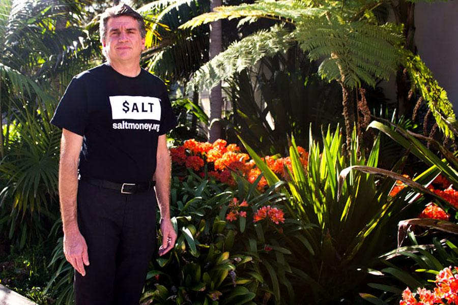 Brad Hardison, director of financial aid at Santa Barbara (Calif.) City College wears his $ALT shirt on April 3. $ALT is a financial aid coaching website that teaches eligable students for free how to manage their money for school and life.